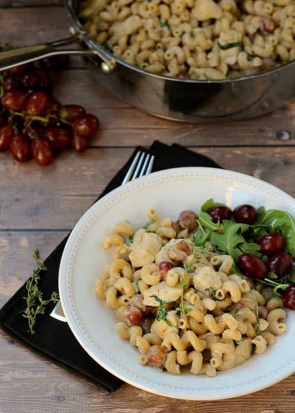 Pasta with Grapes, Chicken, Arugula and a Creamy Dijon Sauce -- an easy weeknight meal or perfect to impress guests! Find the recipe on RachelCooks.com