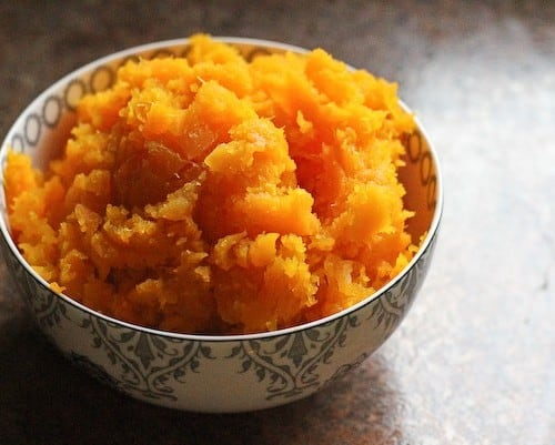 Small decorative bowl containing cooked mashed squash.