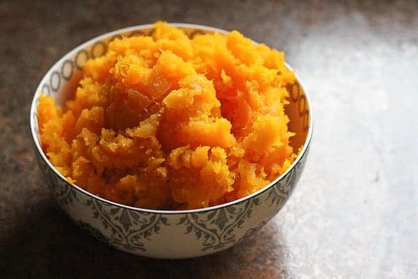 Small decorative bowl containing cooked squash.