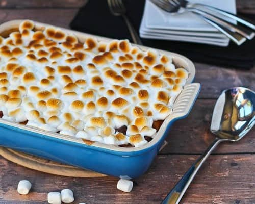 Partial image of sweet potato bread pudding in blue baking dish
