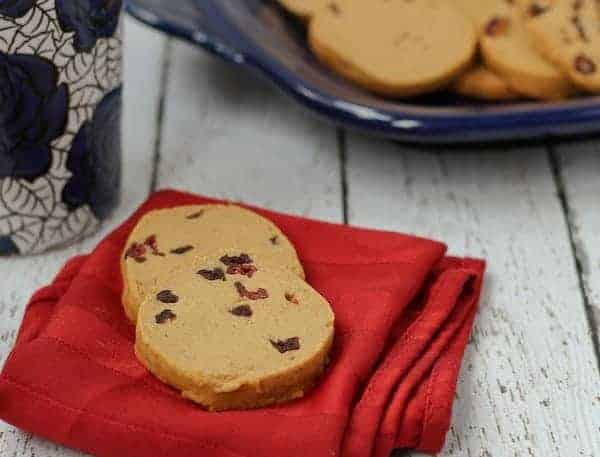 Front view of two cookies on folded red napkin.