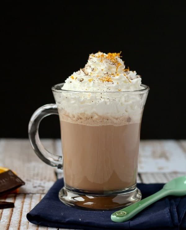 Front view of hot cocoa with black background.