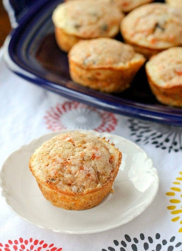 You won't be able to stop eating these amazing carrot cake muffins - a cream cheese filling takes them over the top! Get the easy recipe on RachelCooks.com!