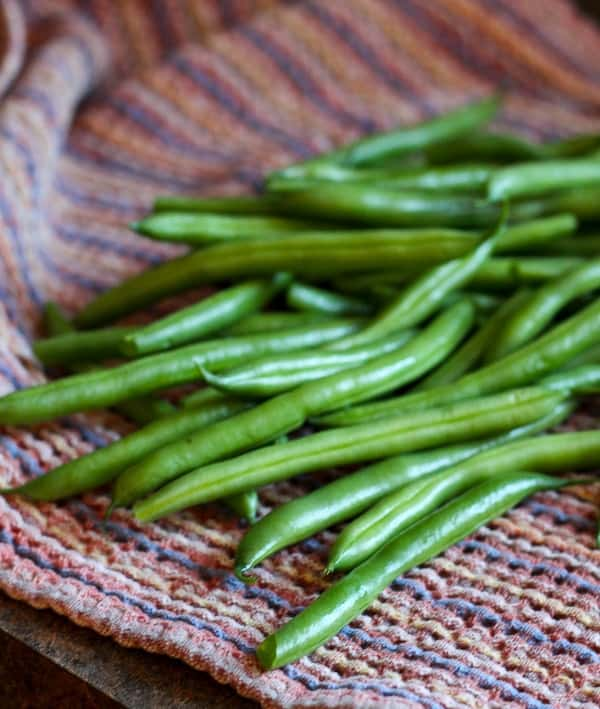Image of fresh green beans on a towel.
