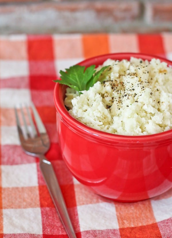 Riced cauliflower in a red bowl.