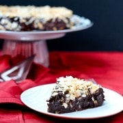 Decadent Flourless Chocolate Cake with Chocolate Ganache and Toasted Coconut - Get the (easy!) recipe on RachelCooks.com