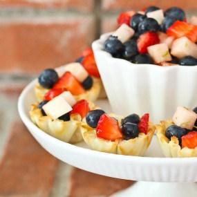 These Mini Patriotic Fruit Tarts are beautiful, easy to make, and a refreshing treat for Memorial Day, Independence Day, or ANY day! Get the EASY recipe on RachelCooks.com!