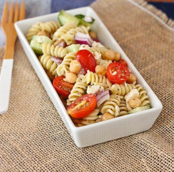 Overhead of pasta salad in rectangular dish.