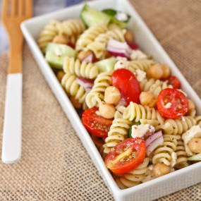 Greek Pasta Salad with Feta - this is a easy, filling, and delicious pasta salad that is perfect for picnics and bbqs. Get the easy recipe on RachelCooks.com!