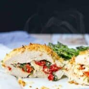 These Sun Dried Tomato, Kale, and Feta Stuffed Chicken Breasts are impressive enough to serve to guests but easy enough to make for weeknight family dinners. You won't believe how simple and delicious these are! Get the easy recipe on RachelCooks.com.
