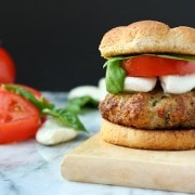 This Mozzarella Stuffed Turkey Burger has all the summer flavors of caprese but in a juicy and healthy turkey burger! Get the recipe on RachelCooks.com!