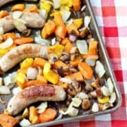 Roasted sausage and vegetables on sheet pan.