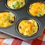 egg white muffins in pan close up with broccoli
