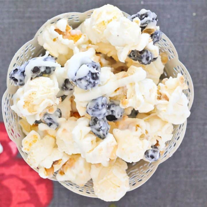 Blueberries & Cream Popcorn is hard to resist. What a unique treat to make for your family! Get the easy recipe on RachelCooks.com!