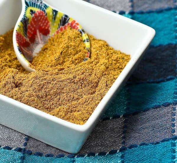 Closeup of curry powder in dish.