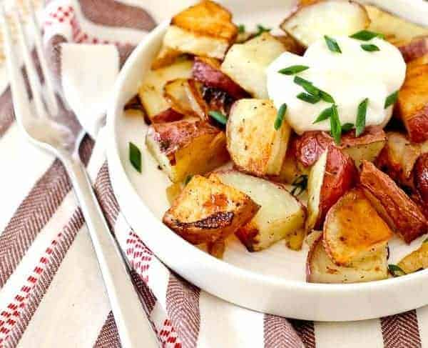 Closeup of potatoes in white dish.