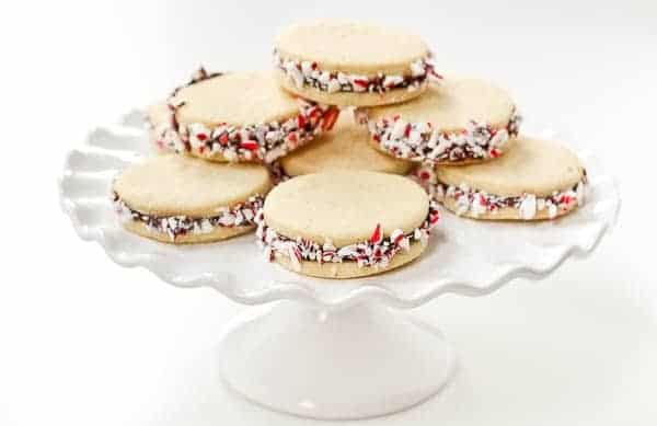 These Peppermint Sugar Cookie Sandwiches with Chocolate Ganache are easy to make and a gorgeous addition to your holiday cookies. Get the recipe on RachelCooks.com!