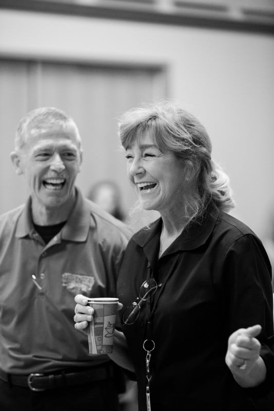 Black and white photo of older couple laughing.