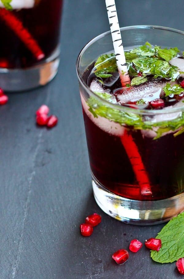This pomegranate mojito is festive enough for the holidays but delicious enough to drink all year long! Get the fun cocktail recipe on RachelCooks.com!