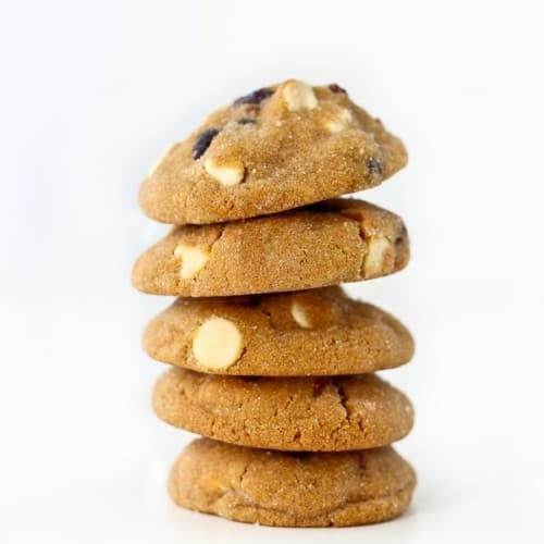 Stack of five gingersnaps on white background.