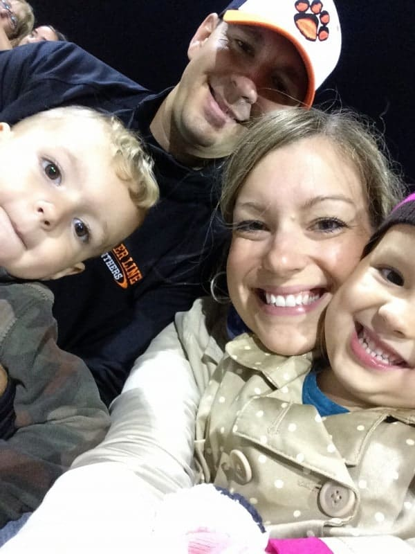 Selfie photo of author with family at football game.