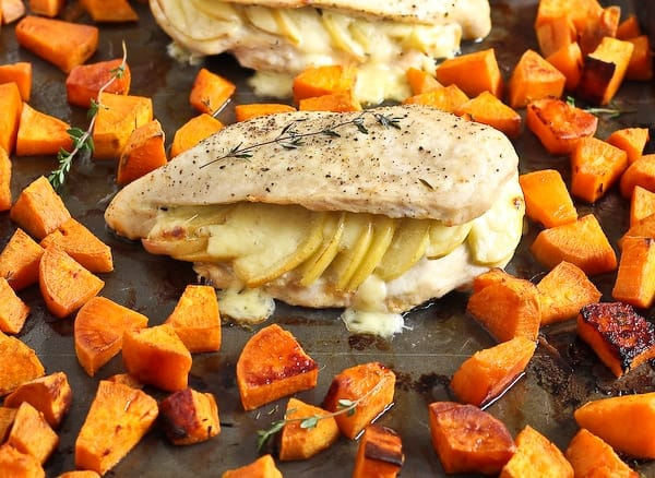 Front view of roasted chicken and sweet potatoes.