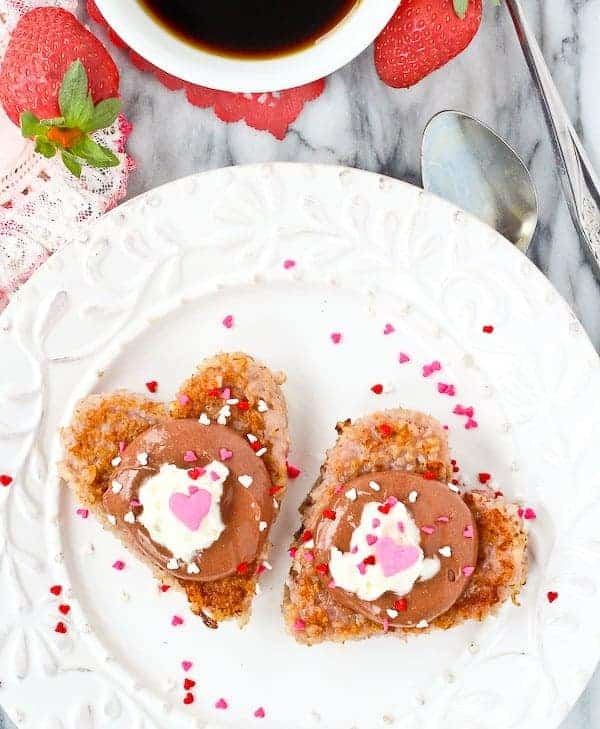 Start Valentine's Day with a healthy and fun breakfast! This Heart Shaped Strawberry Steel Cut Oatmeal Recipe with Chocolate Topping is everything you need to get your day off to a LOVEly start. Get the easy and fun breakfast idea on RachelCooks.com!