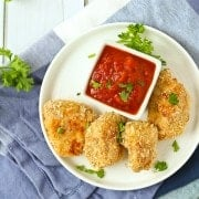 These healthy chicken nuggets with Parmesan are easy to make (baked, not fried!) and kids and adults will adore them. Say goodbye to the drive-thru! Get the easy recipe on RachelCooks.com!