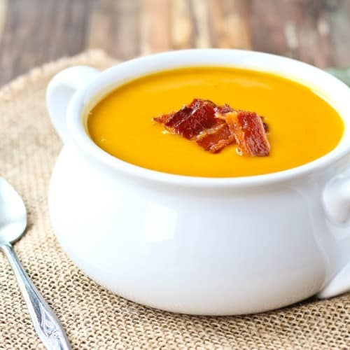 Warm and soothing, this squash soup is easy to make and perfect year-round. You'll love the crispy bacon on top! Get the easy recipe on RachelCooks.com!