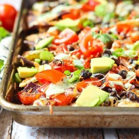 Words cannot express how badly you need these vegetarian nachos in your life. They're great on their own but the creamy cilantro lime drizzle puts them over the top! Get the recipe on RachelCooks.com!