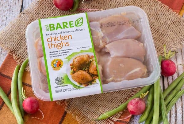 Overhead of package of Just BARE Chicken Thighs.