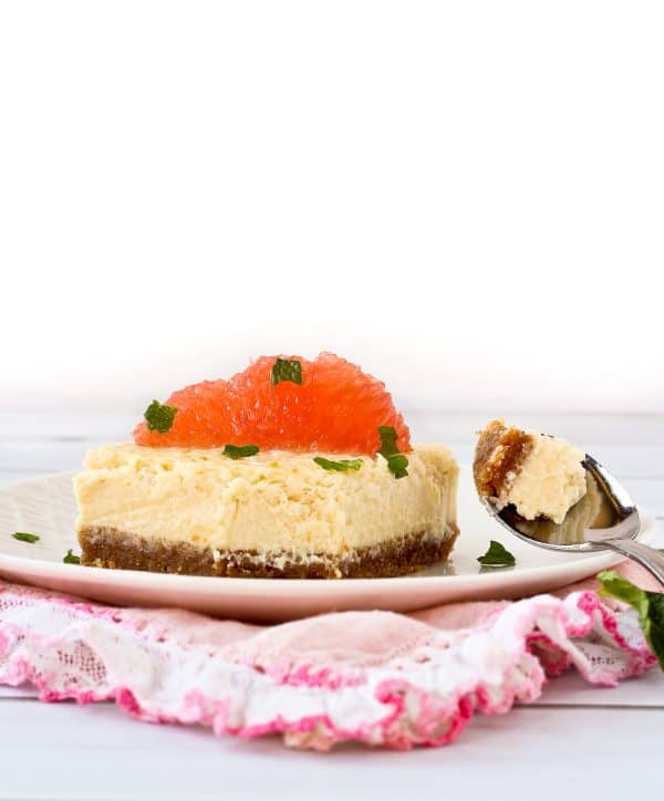 This easy grapefruit cheesecake with mint is rich yet refreshing. It's a perfect summer dessert for any occasion. Get the easy cheesecake recipe on RachelCooks.com!