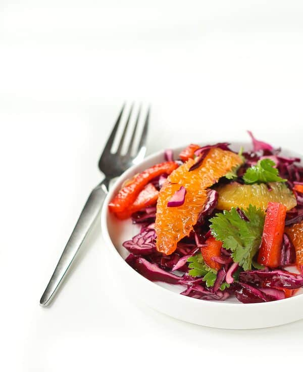 Refreshing and bright, this Red Cabbage Salad Recipe with Honey Lime Dressing is the perfect side to a heavy meal of Mexican food. It's even great on top of tacos! Get the easy recipe on RachelCooks.com!
