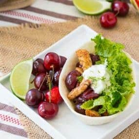 Inspired by Michigan summers, these cherry chicken tacos have a fantastic balance of sweet and savory. The lime sour cream lends the perfect touch of bright citrus flavor to these chicken tacos. Get the easy recipe on RachelCooks.com!