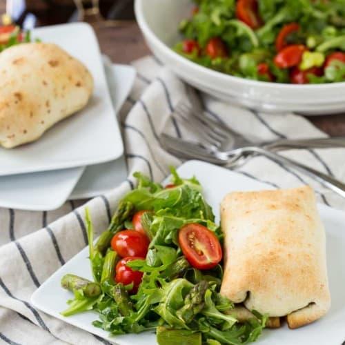 Plated chimichanga with salad.