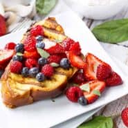 Take your brunch to the grill! This grilled french toast and its strawberry basil cream cheese stuffing will be the perfect brunch centerpiece! Get the recipe on RachelCooks.com!
