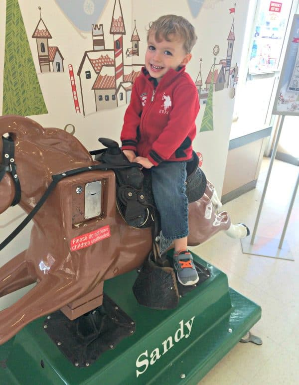Toddler boy on mechanical horse named Sandy, found at Meijer stories.