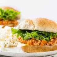 Sloppy Joe on bun with lettuce and cheese.