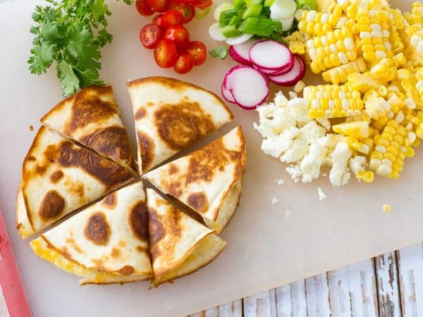 "How about we put the cheese inside the ""chips"" and use quesadillas as the base for some summer-inspired quesadilla nachos? The result is incredible! Get the recipe on RachelCooks.com!"