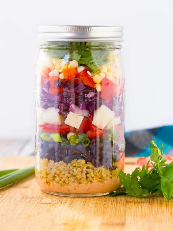 A salad so beautiful, you'll barely want to eat it! But you'll definitely want to because this southwestern chopped salad is full of flavor thanks to an easy to make dressing and tons of great vegetables. Get the fun mason jar salad recipe on RachelCooks.com!