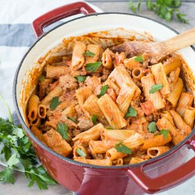 A weeknight dinner dream come true! A complete meal in one pan. This one pan rigatoni is filling, comforting and full of flavor. Get the easy dinner recipe on RachelCooks.com!