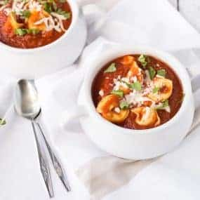 Warm, comforting, and hearty -- all words that describe this simple and easy to make slow cooker tomato basil soup with tortellini. It's going to be a huge crowd pleaser! Get the easy slow cooker recipe on RachelCooks.com!