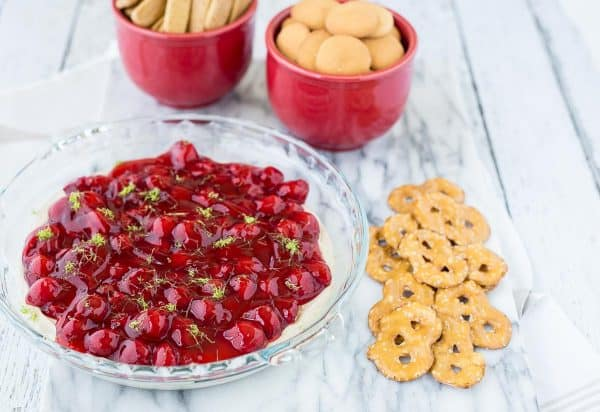 This cherry cheesecake dip with lime is going to become a party favorite. It takes only minutes to make and has fresh and bright flavors thanks to lime juice and zest. Get the easy no-bake dessert recipe on RachelCooks.com! This sweet dip is going to go into regular rotation.