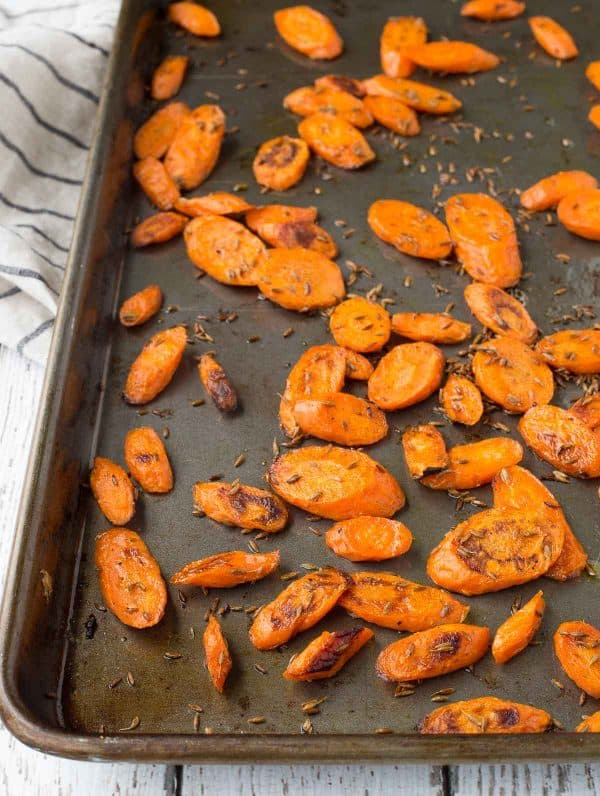 Tired of plain carrots? These roasted carrots with cumin are going to blow your mind with their punch of flavor. A fantastic, unique and healthy side dish. Get the recipe on RachelCooks.com!