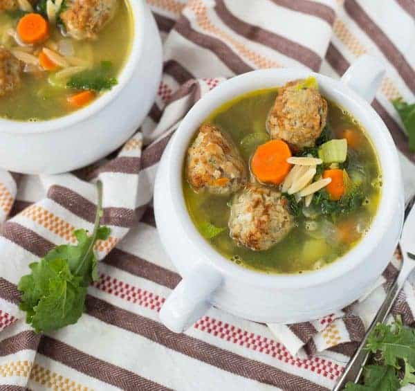 Overhead of meatball soup in bowls.