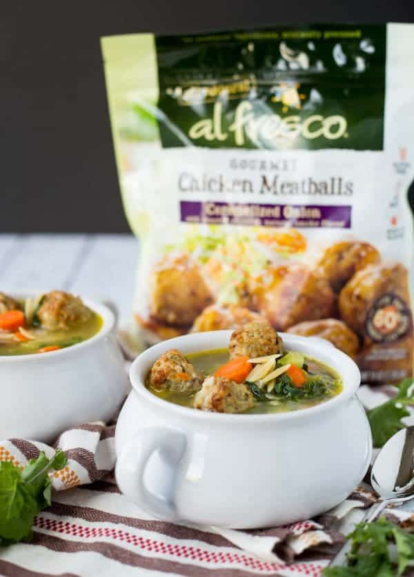Meatball soup in bowls, with package of al fresco chicken meatballs in background.