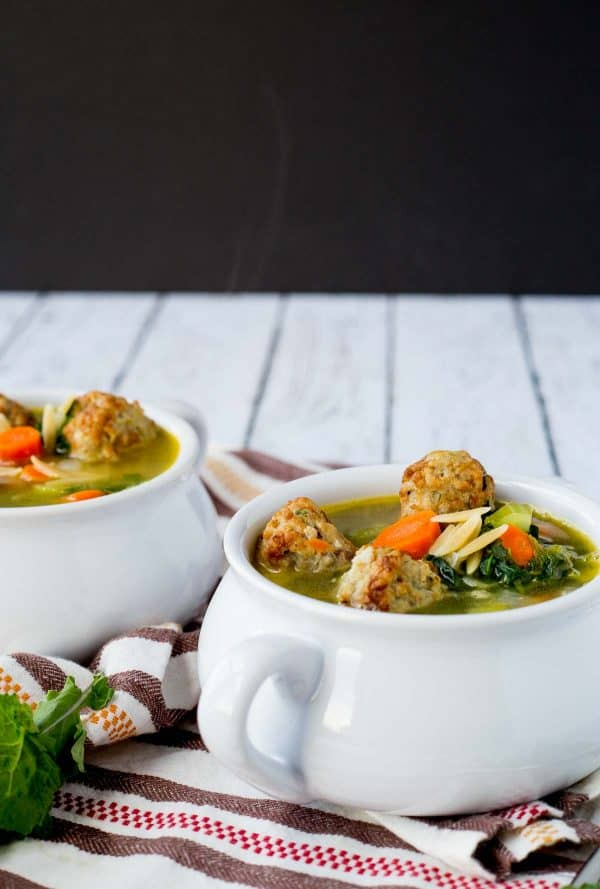 A couple of bowls filled with meatball soup.