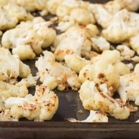 This Parmesan Roasted Cauliflower is going to become your new favorite way to eat cauliflower - it's flavorful, crispy, and so easy to prepare! Get the recipe on RachelCooks.com!