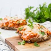 This Chicken Parmesan Stuffed Portobello Mushrooms recipe is a quick, healthy, and easy meal for busy weeknights. You could even use rotisserie chicken! Get the stuffed mushroom recipe on RachelCooks.com!
