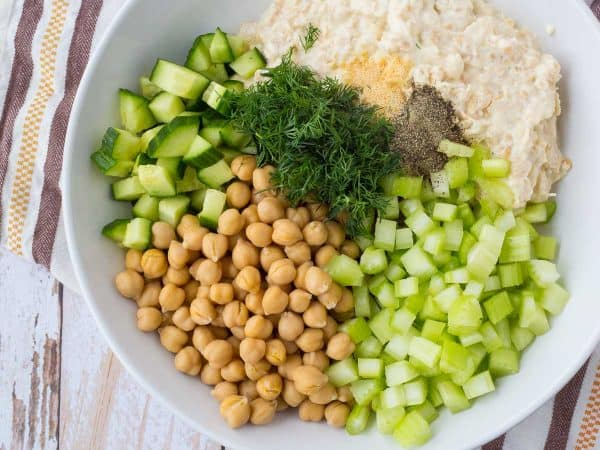 If you're looking for a healthy and easy to make vegetarian meal that will still fill you up and leave you feeling satisfied, look no further. This lemon dill chickpea salad recipe is just what you need. Get the recipe on RachelCooks.com!